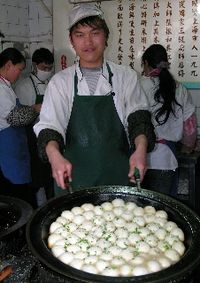 Fried dumplings in Old Town Shanghai (Photo by David G. Molyneaux, TheTravelMavens.com)