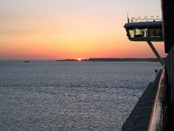 Emerald Princess leaves Lisbon with the setting sun for a crossing of the Atlantic (Photo by David G. Molyneaux, TheTravelMavens.com)