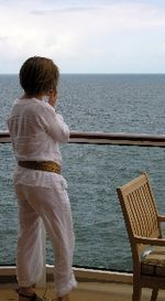 Cell phoning on the Celebrity Equinox off the coast of England. (Photo by David G. Molyneaux, TheTravelMavens.com)