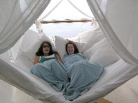Mother and daughter from Surrey, England, snuggle in a tented nook on the Celebrity Equinox (David G. Molyneaux, TheTravelMavens.com)