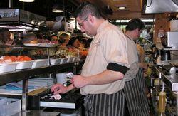 Busy lunch counter at La Boqueria Market, Barcelona, Spain (Photo by David G. Molyneaux, TheTravelMavens.com)