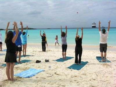 Tai chi on the the beach at Half Moon Cay, while Nieuw Amsterdam waits offshore (Photo by David G. Molyneaux, TheTravelMavens.com)