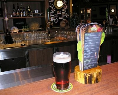 A glass of Thirsty Frog Red in the RedFrog Pub on the new Carnival Magic (Photo by David G. Molyneaux, TheTravelMavens.com)