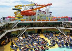 Pool deck on Carnival Magic, with the Water Park behind (Photo by David G. Molyneaux, TheTravelMavens.com)