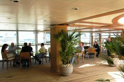 This outdoor section on Oceania Marina is one of only two places on the 1,250-passenger ship where smoking is allowed. (Photo by David G. Molyneaux, TheTravelMavens.com)