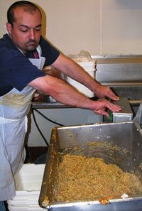Matt Fontenot makes boudin at The Sausage Link in Sulpher, La. (Photo by David G. Molyneaux, TheTravelMavens.com)