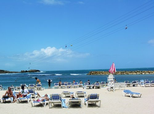 Zip lining at the beach in Labadee, Haiti, costs $89 for the long run from a hilltop to Royal Caribbean's private compound. (Photo by David G. Molyneaux, TheTravelMavens.com)