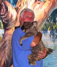 David Molyneaux hugging a koala at Cairns Zoo in Queensland, Australia (TheTravelMavens.com)