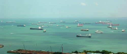 Cargo ships anchored off the harbor at Singapore (Photo by David G. Molyneaux, TheTravelMavens.com)