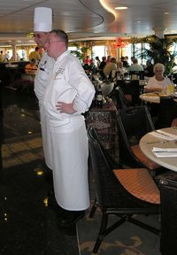 Christophe Belin, Riviera's senior executive chef, right, and Raffaele Saia, Italian Chef de Cuisine, make regular appearances in the Terrace Café to talk with passengers (Photo by David G. Molyneaux, TheTravelMavens.com)