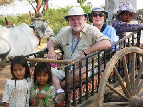 An ox cart ride for David Molyneaux and Fran Golden in Cambodia (Photo by David G. Molyneaux, TheTravelMavens.com)