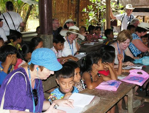 Avalon Angkor passengers join a class learning English in Angkor Ban, Cambodia, after shopping for school supplies that were donated. (Photo by David G. Molyneaux, TheTravelMavens.com)