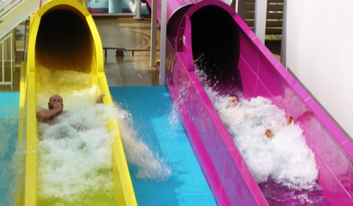 Two of the five water slides on Norwegian Breakaway, where 84 of 4,028 passengers sleep in The Haven, a ship within a ship  (Photo by David G. Molyneaux, TheTravelMavens.com)