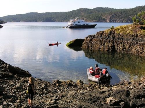 Safari Quest anchors off Jedediah Island Marine Provincial Park, British Columbia, for Un-Cruise passengers to kayak and ride a skiff to shore. (Photo by David G. Molyneaux, TheTravelMavens.com)