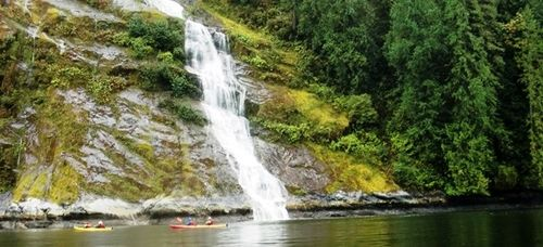 Kayaking close to the mountainside in Princess Louisa Inlet, British Columbia