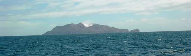 Approaching by boat to volcanic White Island from Whatakane, New Zealand (Photo by David G. Molyneaux, TheTravelMavens.com)