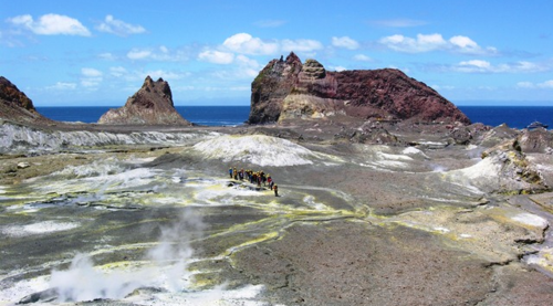 A tour group begins its walk at the tip of a volcano on White Island (Photo by David G. Molyneaux, TheTravelMavens.com)