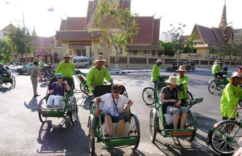 Cyclo taxis in Phnom Penh, Cambodia  (Photo by David G. Molyneaux, TheTravelMavens.com)