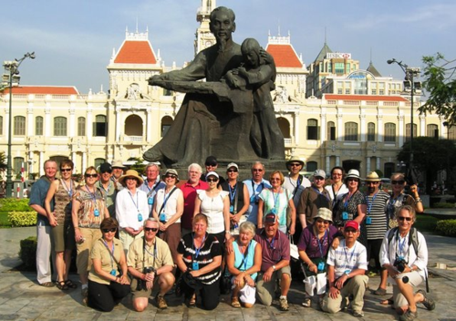 Our tour group stopped for a picture in front of a statue to Uncle Ho, also known as Ho Chi Minh (TheTravelMavens.com)