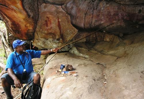 Wilfred Gordon at his ancestor's birth cave (Photo by David G. Molyneaux, TheTravelMavens.com)