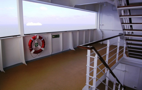 A nearly private back stairway on MSC Divina connects cabins on several decks to the buffet restaurant and pool above. (Photo by David G. Molyneaux, TheTravelMavens.com)