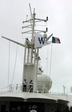 Officers of Star Pride slowly raise the flag of Windstar Cruises at daily sail-aways, to the music of '1492: Conquest of Paradise' (Photo by David G. Molyneaux, TheTravelMavens.com)