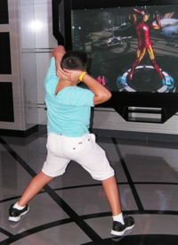 Twisting with Iron Man on Disney Magic (Photo by David G. Molyneaux, TheTravelMavens.com)