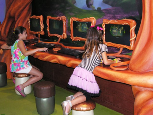 In Pixie Hollow, land of Tinker Bell, children sit on stools shaped like mushrooms and acorns to make crafts (Photo by David G. Molyneaux, TheTravelMavens.com)