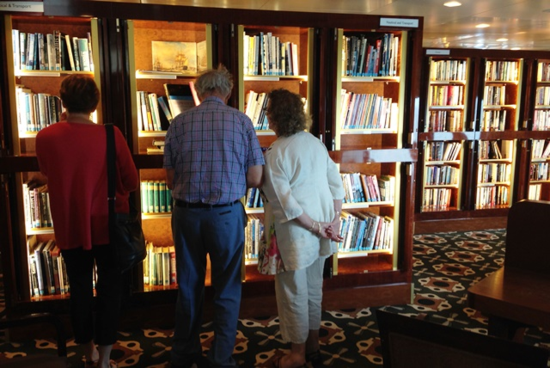 Searching in the library on Queen Mary 2 (Photo by David G. Molyneaux, TheTravelMavens.com)