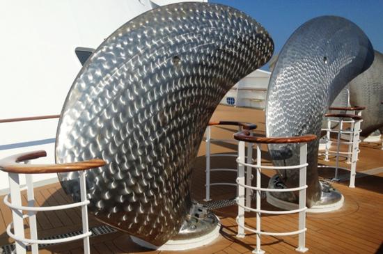 Artwork on Queen Mary 2? No, spare propeller blades for a big ship (Photo by David G. Molyneaux, TheTravelMavens.com)