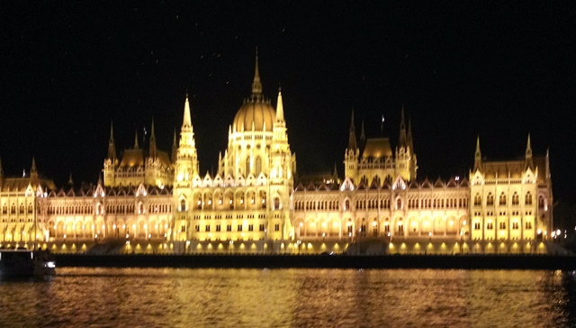 Budapest glows at night from the Danube River (Photo by David G. Molyneaux, TheTravelMavens.com)