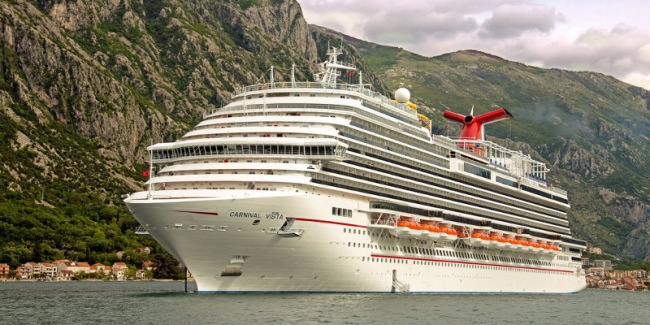 Carnival Vista, anchored at Kotor, Montenegro, is cruising the Mediterranean Sea this summer, arriving in Miami in November (Photo by Carnival Cruise Line, TheTravelMavens.com)