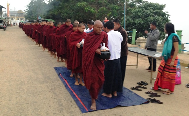 Monks line up for breakfast beside the Irrawaddy, compliments of the crew of Avalon Myanmar (Photo by David G. Molyneaux, TheTravelMavens.com)