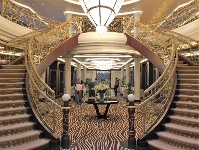 The sophisticated atrium entrance to Compass Rose, main dining room on Seven Seas Explorer. (Photo by David G. Molyneaux, TheTravelMavens.com)