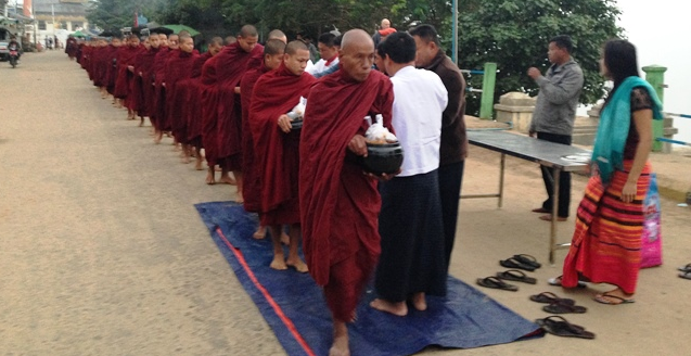 Monks line up for breakfast beside the Irrawaddy (photo by David G. Molyneaux, TheTravelMavens.com)