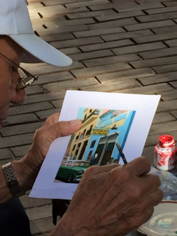 Street artist at Plaza de Armas (Photo by David G. Molyneaux, TheTravelMavens.com)