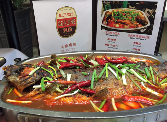 Popular on Chinese cruises for lunch at Michael's Genuine American gastropub is a whole fish in a very spicy pepper sauce (Photo by David G. Molyneaux, TheTravelMavens.com)