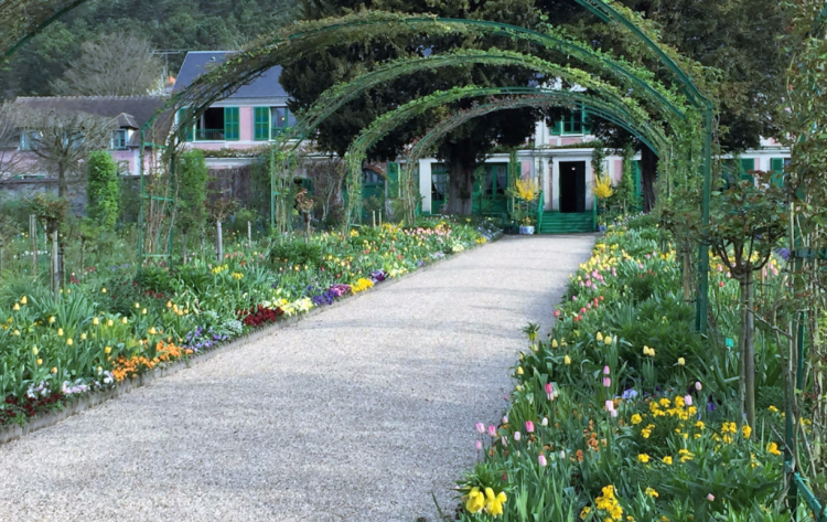 Even in early spring, the garden at Claude Monet's home in Giverny is a colorful delight for Seine River cruise passengers. (Photo by David G. Molyneaux, TheTravelMavens.com)