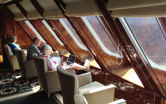Popular spot in the library at the bow of Queen Mary 2, crossing the Atlantic on Cunard's 175th anniversary voyage  (Photo by David G. Molyneaux, TheTravelMavens.com)