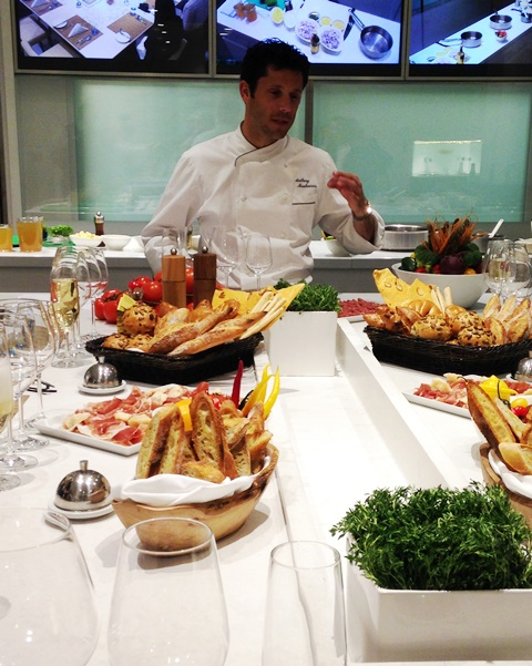 Chef Anthony Mauboussin prepares dinner with passengers in the Chef's Kitchen of Viking Ocean's Viking Star (Photo by David G. Molyneaux, TheTravelMavens.com)