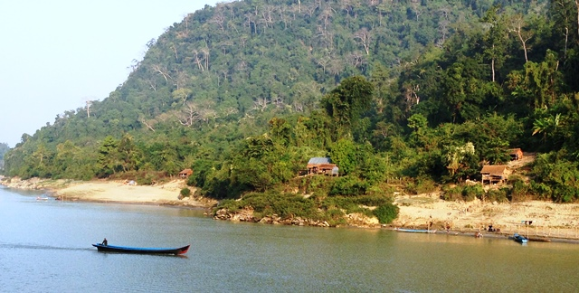 Occasional villages on the Irrawaddy in northern Myanmar (Photo by David G. Molyneaux, TheTravelMavens.com)