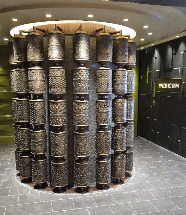 The prayer wheel sits at the middle of the entrance to the ship's new Pan-Asian restaurant, Pacific Rim. (Photo by David G. Molyneaux, TheTravelMavens.com)
