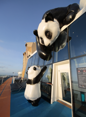 A mother panda and her cub reach out to one another on Ovation of the Seas in a work by U.K. artist Jo Smith.
