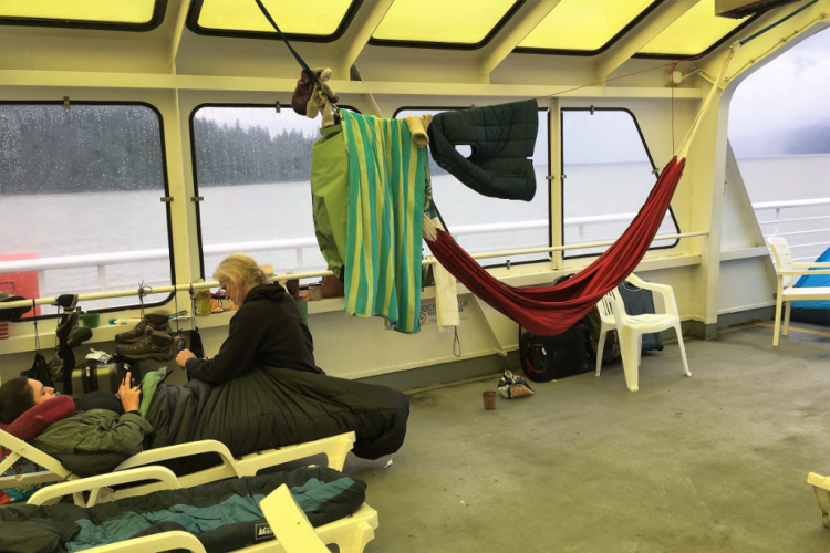 Some ferry passengers spend the night in the top deck solarium in a lawn chair or string a hammock. Fran Golden TheTravelMavens.com