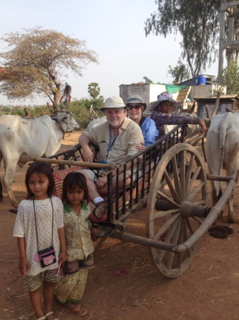 David and his wife Fran Golden riding on an ox cart in remote Kampong Tralach,Cambodia