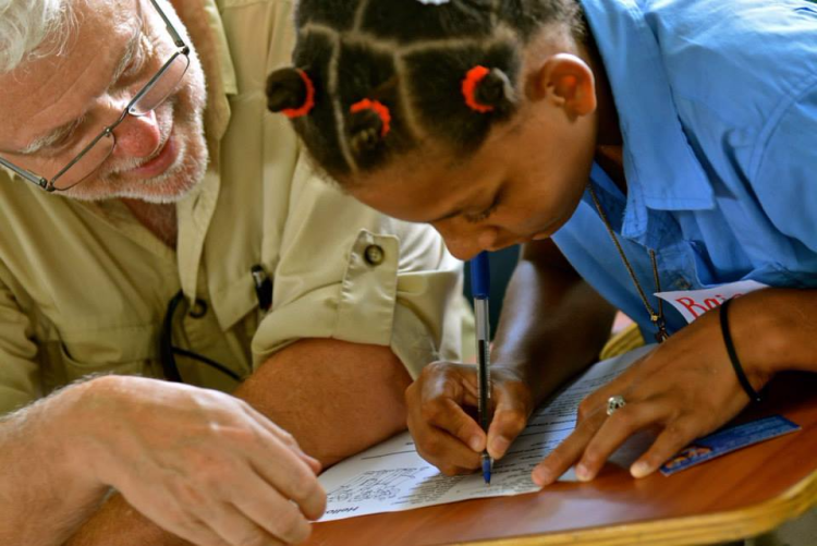Helping Raisa learn to write English at the Isabel Meyreles School in the Dominican Republic near Puerta Plata.