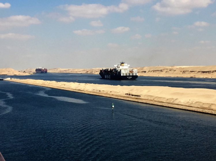 Container ships and tankers in a convoy heading north in the Suez Canal. (photo by David G. Molyneaux, TheTravelMavens.com)