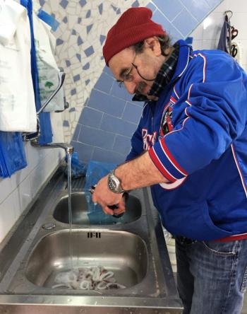Minori's fish monger cleans and cuts calamari (Photo by David G. Molyneaux, TheTravelMavens.com)