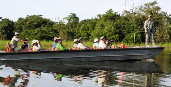 Skiff exploring from the Delfin II in the Upper Amazon, Peru  (Photo by David G. Molyneaux, TheTravelMavens.com)