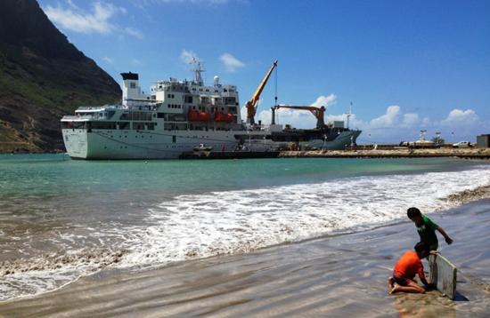 Aranui 3 unloading freight at Hakahau on the island of Ua Pou in the Marquesas of the South Pacific (Photo by David G. Molyneaux, TheTravelMavens.com)